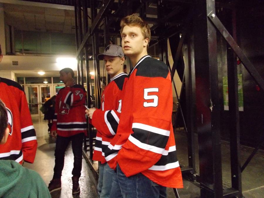 Adam Larsson watching...(Harri Pesonen behind him)
