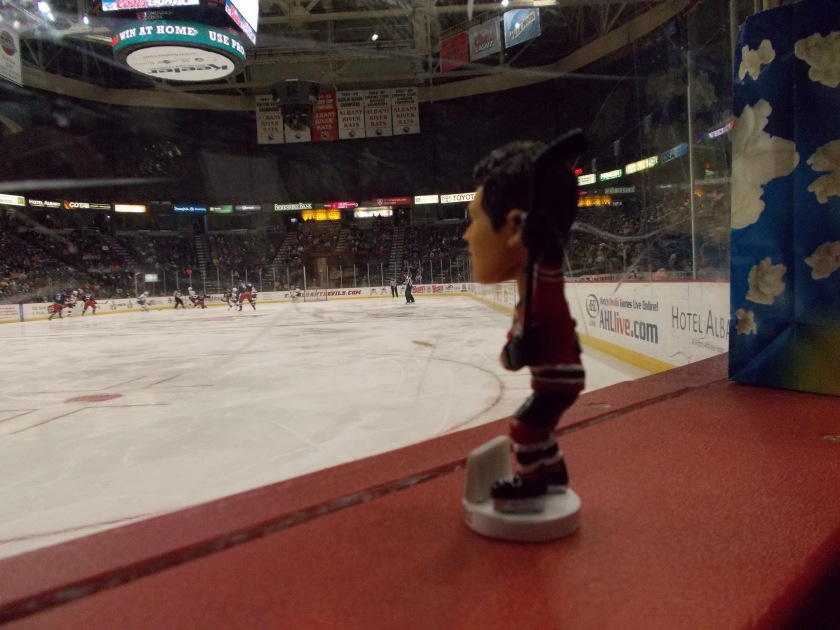 Eric Gelinas' bobblehead likeness checking out the action...