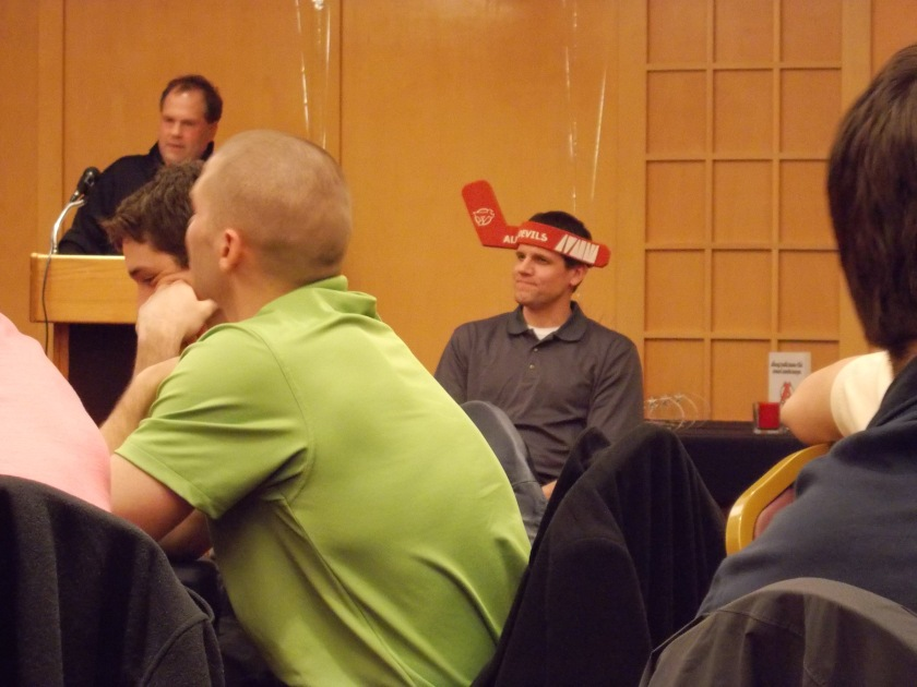Our guest speaker decided to give Coach the fan experience, complete with ridiculous hat.  And a cowbell.