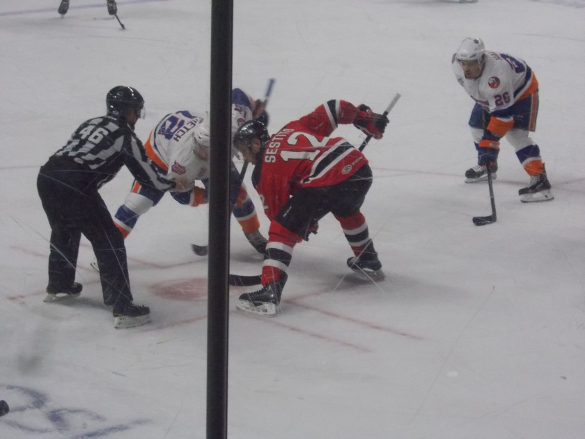 Tim Sestito with the faceoff...