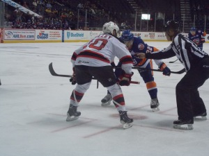 The Captain with the faceoff...